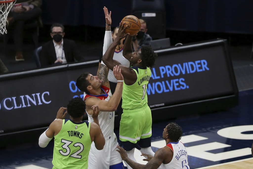 Minnesota Timberwolves' Anthony Edwards (1) shoots against New Orleans Pelicans' Willy Hernangomez (9) during the first half of an NBA basketball game...