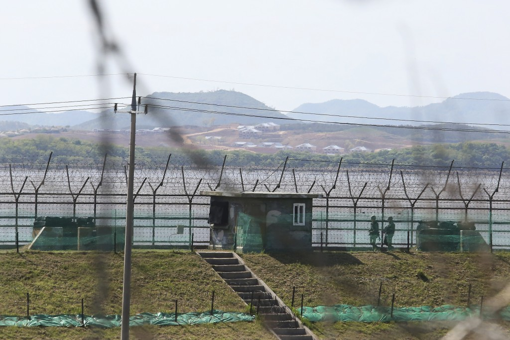 South Korean army soldiers patrol along the barbed-wire fence in Paju, South Korea, near the border with North Korea, Sunday, May 2, 2021. North Korea...
