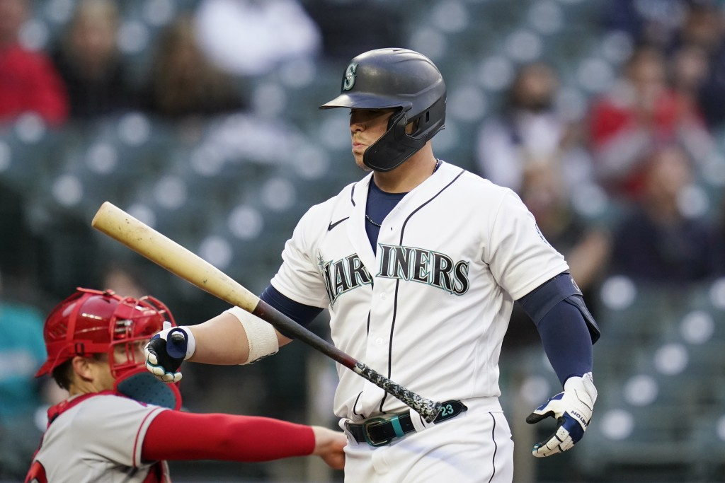 Seattle Mariners' Ty France walks away from the plate after striking out against the Los Angeles Angels during the third inning of a baseball game Sat...
