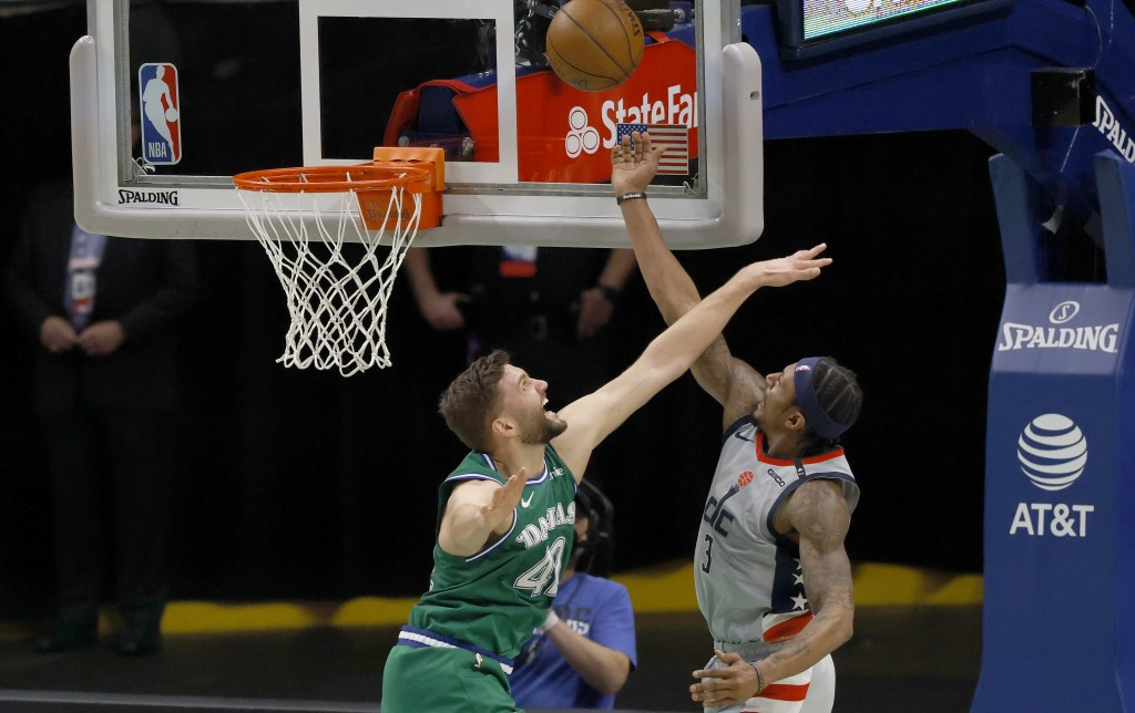 Washington Wizards guard Bradley Beal (3) shoots over Dallas Mavericks forward Maxi Kleber (42) during the first half of an NBA basketball game Saturd...