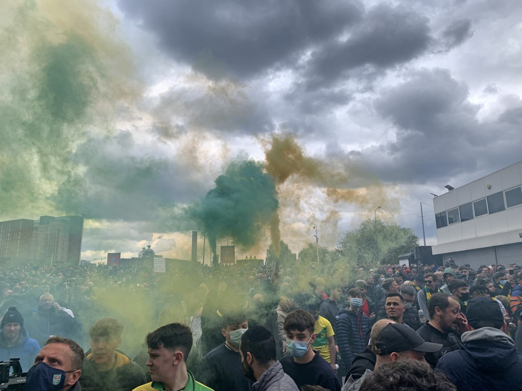 Manchester United fans hold flares as they protest outside of Old Trafford, during a protest against the Glazer family, owners of Manchester United, b...