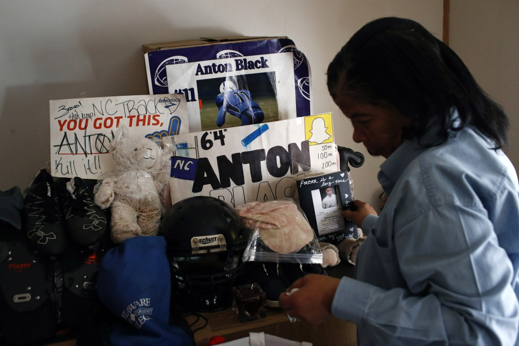 FILE - In this Jan. 28, 2019 file photo, Jennell Black, mother of Anton Black, looks at a collection of her son's belongings at her home in Greensboro...