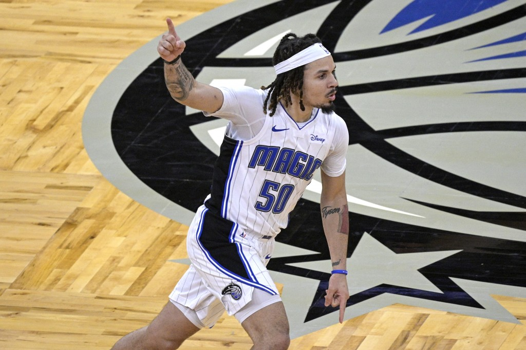 Orlando Magic guard Cole Anthony (50) celebrates after scoring the winning basket during the second half of an NBA basketball game against the Memphis...