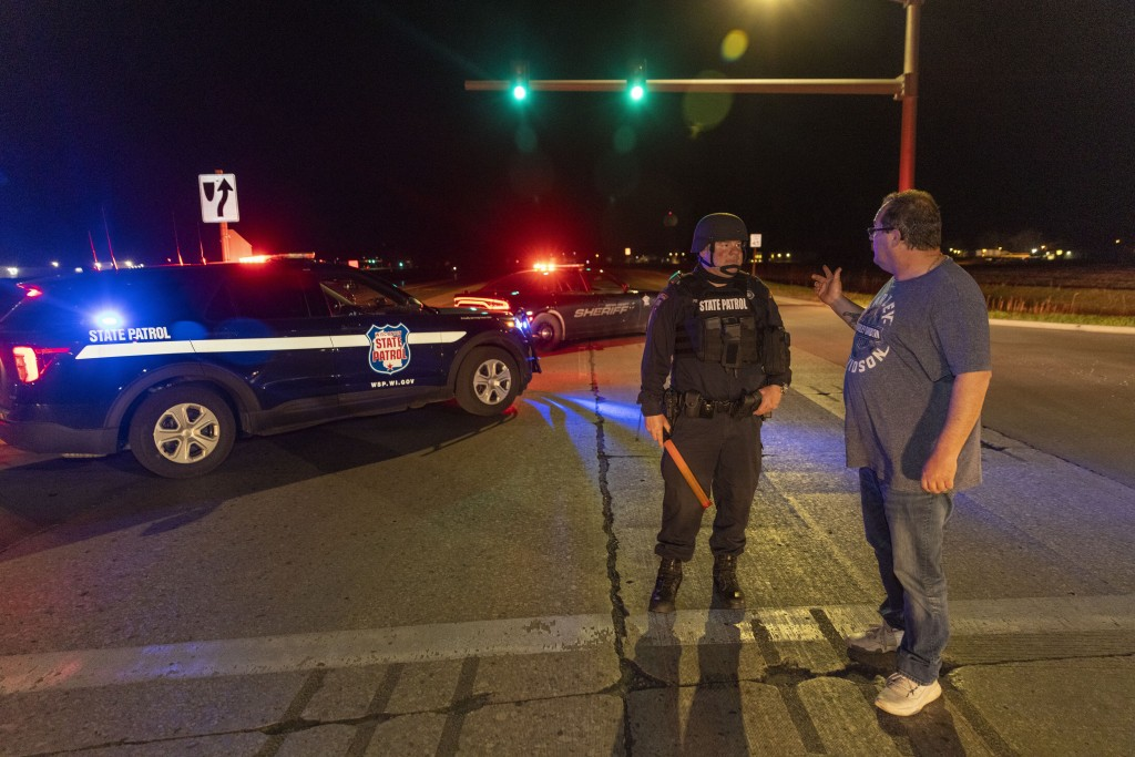 A State Patrol officer blocks the road in front of the Oneida Bingo and Casino in Green Bay, Wis on Saturday May 1, 2021 after reports of an active sh...