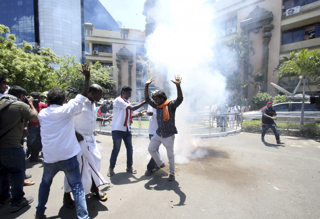 Dravida Munnetra Kazhagam (DMK) party cadres celebrate burn firecrackers as they celebrate early leads for the party in the Tamil Nadu state assembly ...