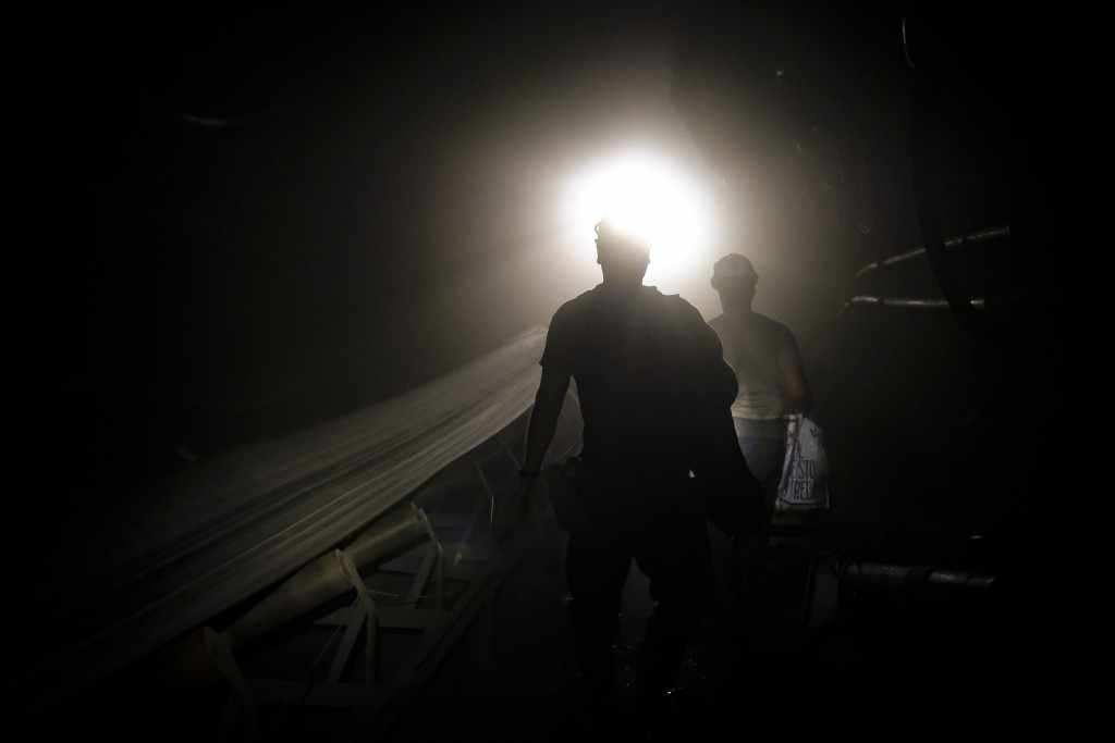 Bosnian coal miners walk in an underground tunnel at a mine in Zenica, Bosnia, Thursday, April 29, 2021. During Ramadan, observant Muslims abstain fro...
