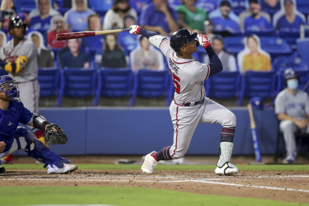 Atlanta Braves Cristian Pache follows through on a grand slam home run in front of Toronto Blue Jays catcher Alejandro Kirk during the second inning o...