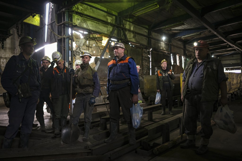 Bosnian coal miners wait for an elevator to take them underground at a mine in Zenica, Bosnia, Thursday, April 29, 2021. Bosnia's coal mines, includin...