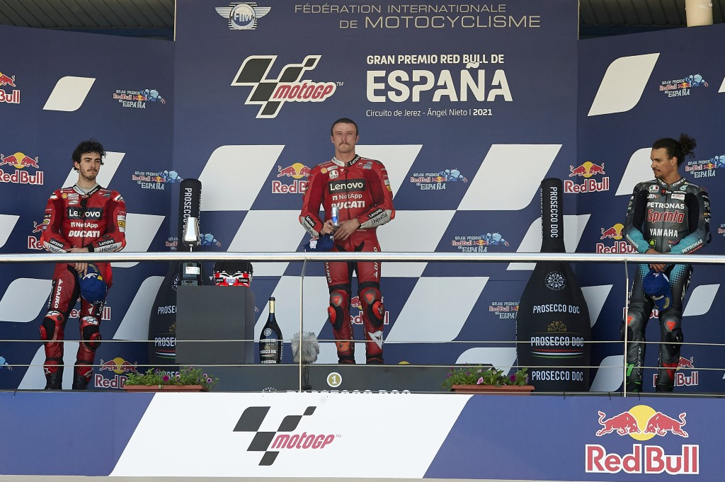 Winners on the podium, with left to right, Italian rider Francesco Bagnaia, winner Australian Jack Miller and Italian rider Franco Morbidelli after af...