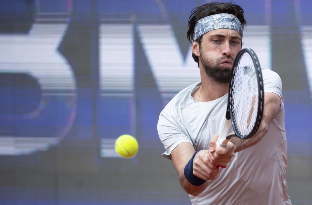 Nikoloz Basilashvili of Georgia returns the ball to Jan-Lennard Struff of Germany during his tennis ATP final match in Munich, Germany, Sunday, May 2,...