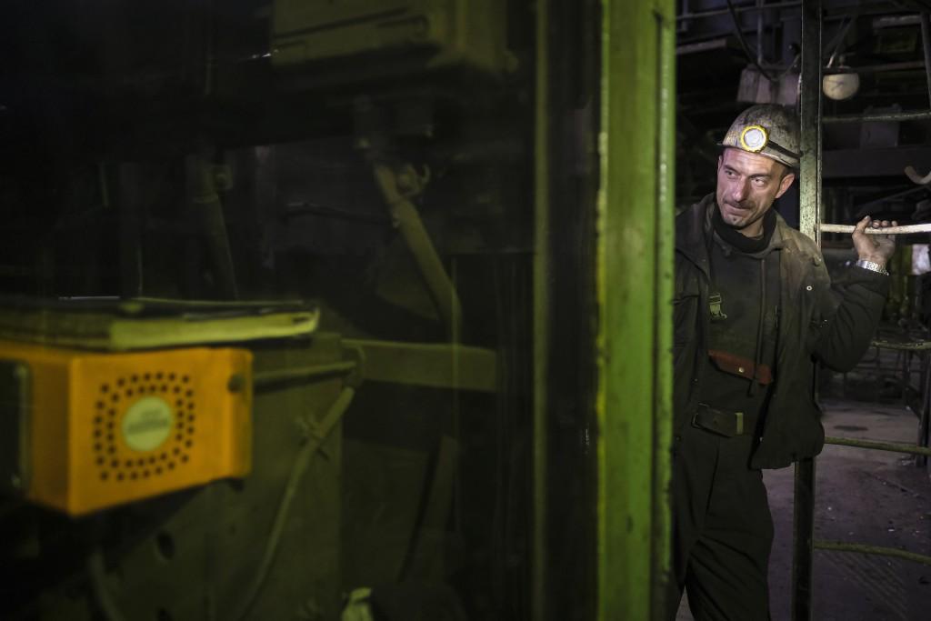 A Bosnian coal miner checks equipment in an underground tunnel at a mine in Zenica, Bosnia, Thursday, April 29, 2021. During Ramadan, observant Muslim...