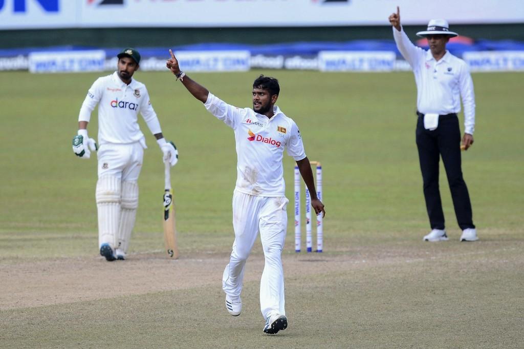 Sri Lanka bowler Ramesh Mendis, center, celebrates after dismissal of Bangladeshi batsman Mushfiqur Rahim during the fourth day of the second test cri...