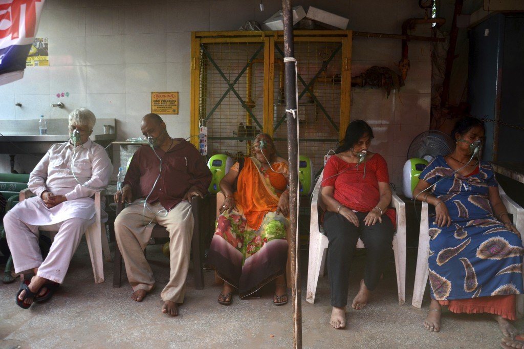 COVID-19 patients receive oxygen outside a Gurdwara, a Sikh house of worship, in New Delhi, India, Saturday, May 1, 2021. India on Saturday set yet an...