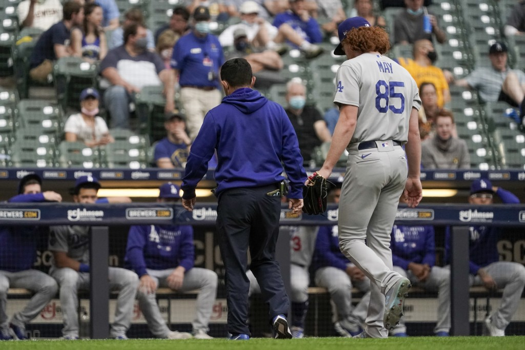 Los Angeles Dodgers starting pitcher Dustin May leaves the game after being injured during the second inning of a baseball game against the Milwaukee ...