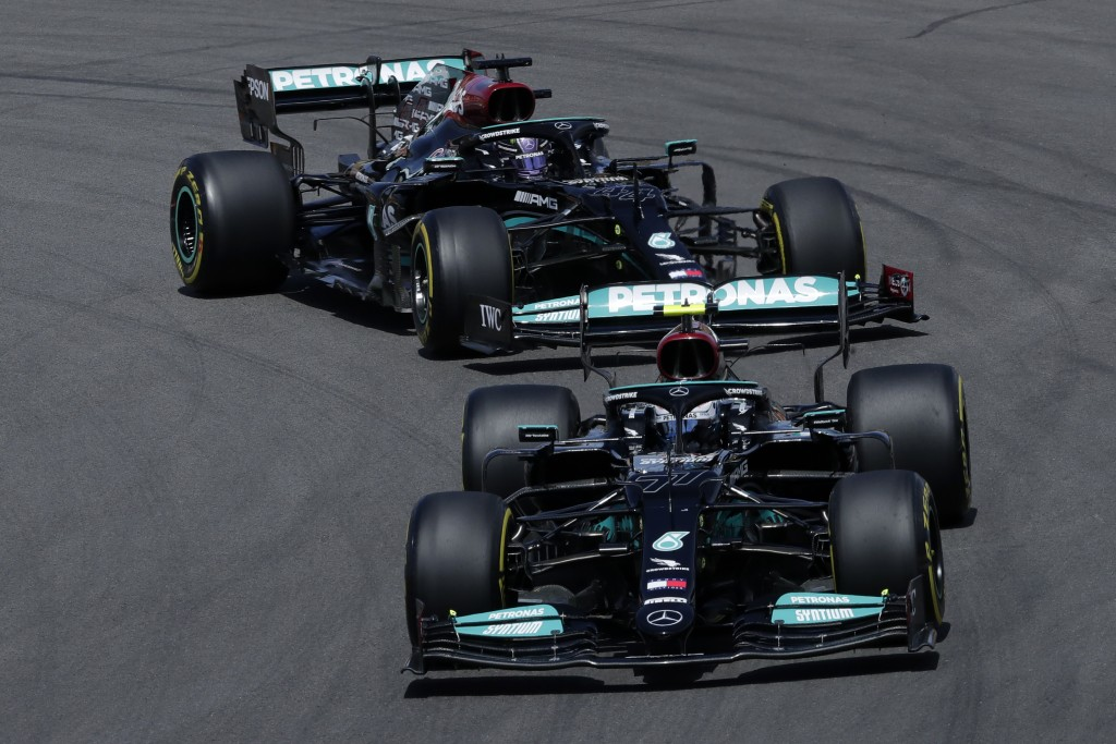 Mercedes driver Valtteri Bottas of Finland takes a curve followed by Mercedes driver Lewis Hamilton of Britain during the Portugal Formula One Grand P...