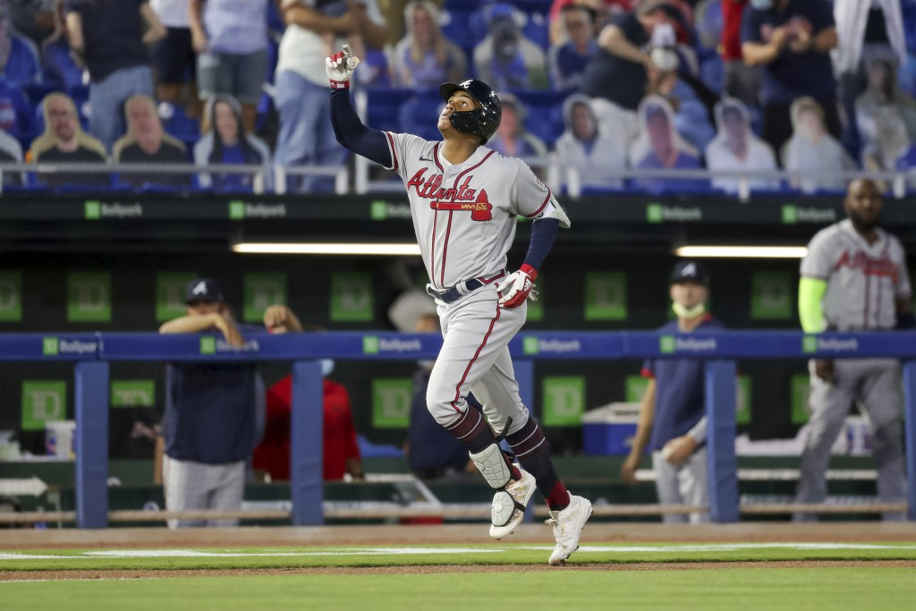 Atlanta Braves Cristian Pache celebrates as he rounds the bases after his grand slam home run against the Toronto Blue Jays during the second inning o...