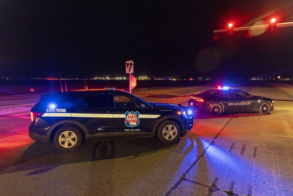 Law enforcement blocks the road in front of the Oneida Bingo and Casino in Green Bay, Wis on Saturday May 1, 2021 after reports of an active shooter. ...