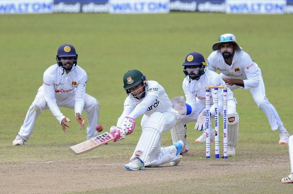 Bangladeshi batsman Mushfiqur Rahim plays a shot during the fourth day of the second test cricket match between Sri Lanka and Bangladesh in Pallekele,...