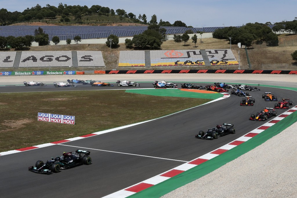 Mercedes driver Valtteri Bottas of Finland, left, leads at the start of the Portugal Formula One Grand Prix at the Algarve International Circuit near ...