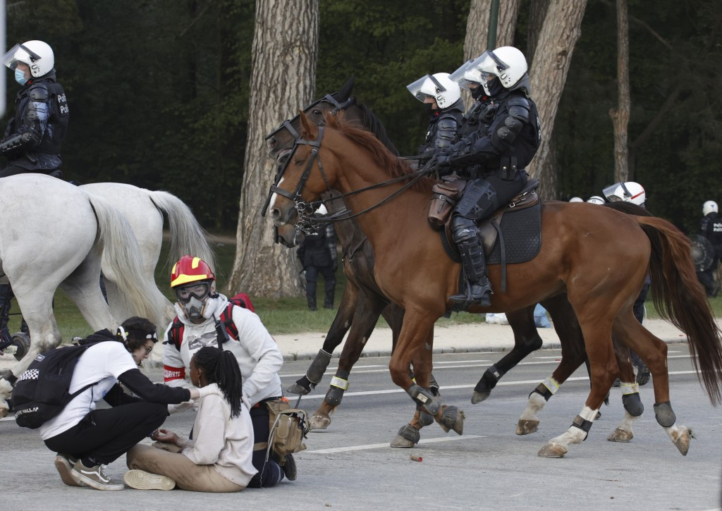 """Police disperse protestor8 at the Bois de la Cambre park during a party called """"La Boum 2"""" in Brussels, Saturday, May 1, 2021. A few thousand people g..."""