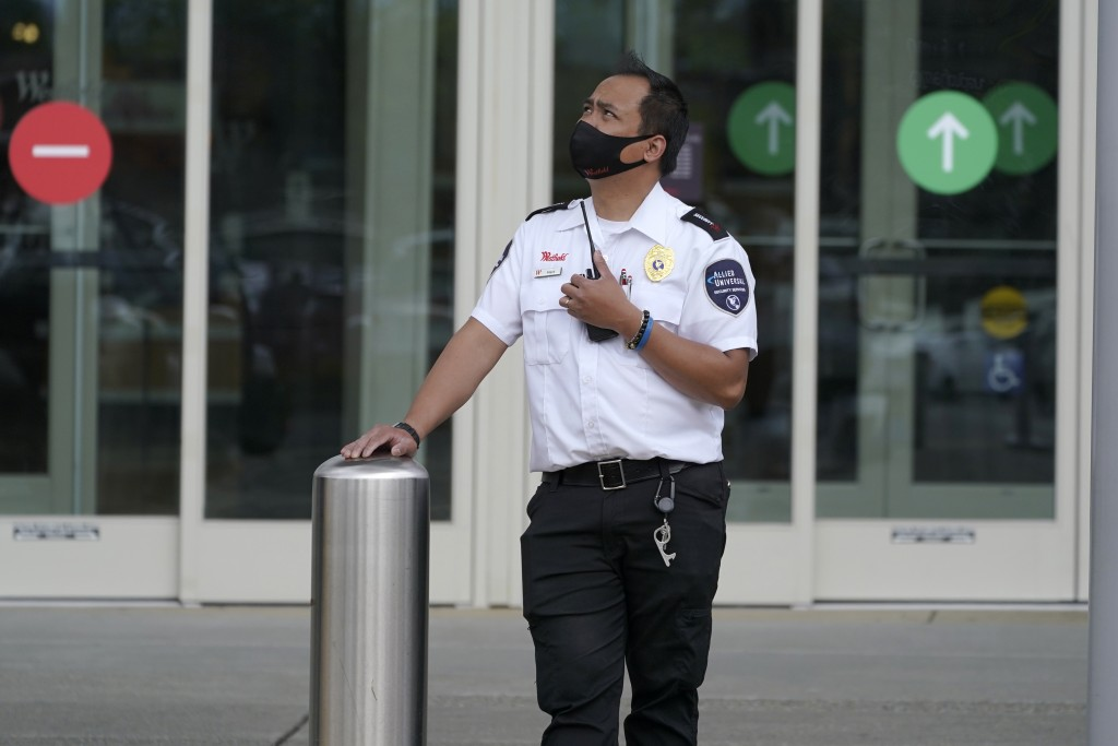A security guard stands near an entrance at the Westfield Southcenter Mall following a reported shooting, Saturday, May 1, 2021, at the mall in Tukwil...