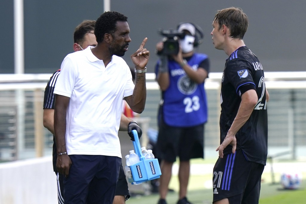 CF Montreal head coach Wilfried Nancy, left, talks with midfielder Lassi Lappalainen during the second half of an MLS soccer match against Columbus Cr...
