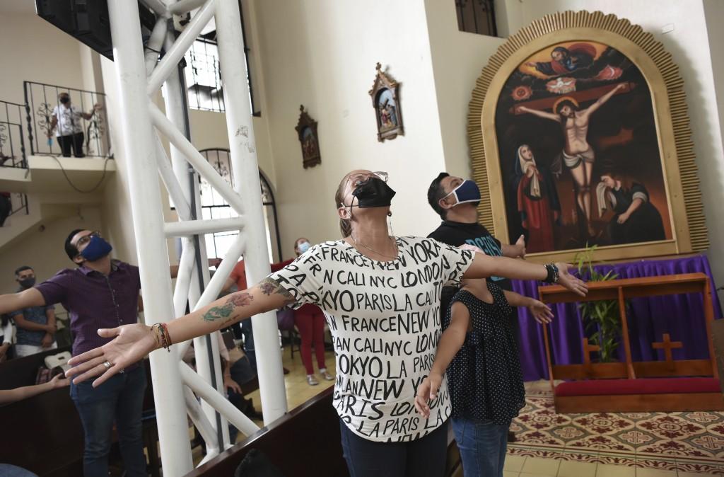 "Faithfull pray during a mass by Sergio Valverde Espinoza, a Catholic priest of the Cristo Rey church who modified a popular song called ""Sopa de Carac..."