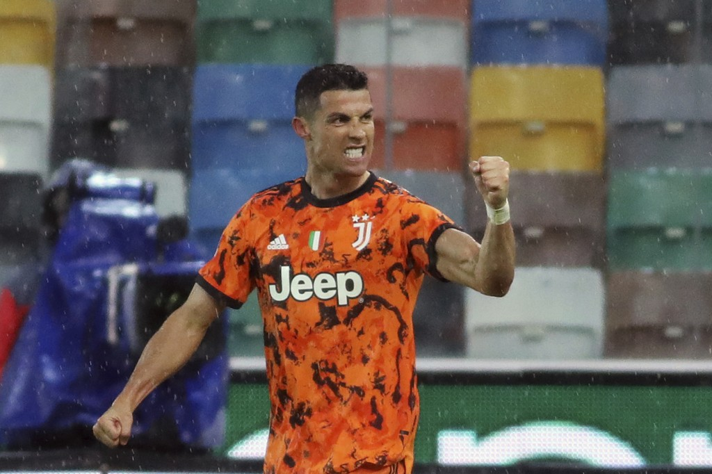 Juventus' Cristiano Ronaldo celebrates after scoring his second and winning goal during the Italian Serie A soccer match between Udinese and Juventus ...
