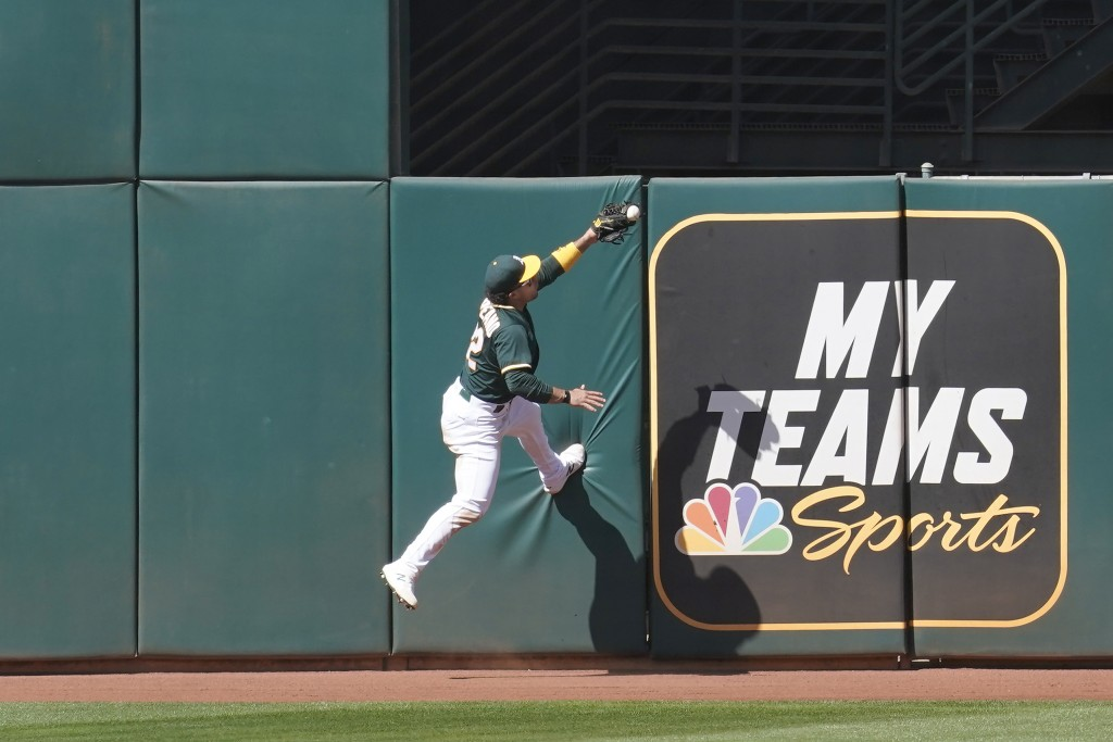Oakland Athletics center fielder Ramon Laureano catches a fly ball during the eighth inning of a baseball game in Oakland, Calif., Sunday, May 2, 2021...