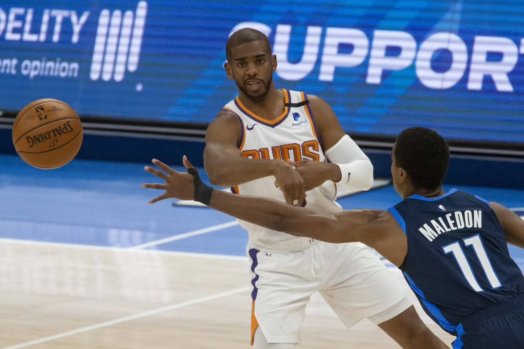 Phoenix Suns guard Chris Paul (3) passes the ball away from Oklahoma City Thunder guard Theo Maledon (11) during the first half of an NBA basketball g...