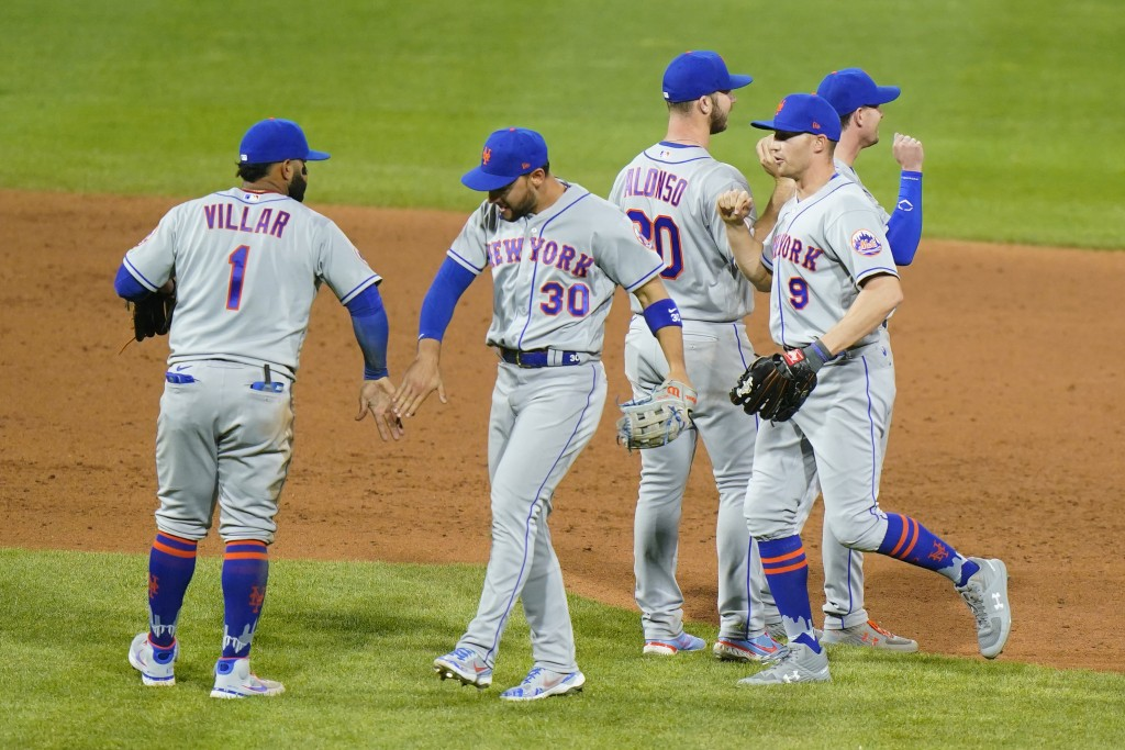 New York Mets' Jonathan Villar, from left, Michael Conforto, Pete Alonso, Brandon Nimmo and Jeff McNeil celebrate after a baseball game against the Ph...