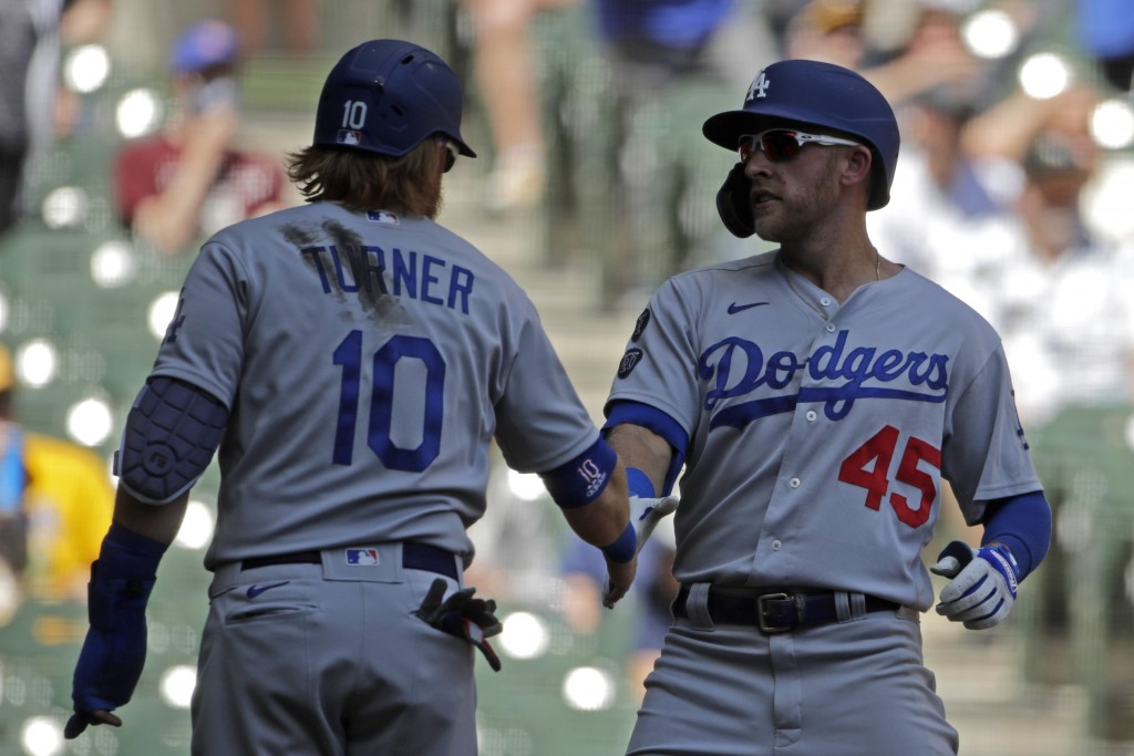 Los Angeles Dodgers' Matt Beaty, right,  is congratulated by Justin Turner, left,  after hitting a grand slam during the second inning of a baseball g...