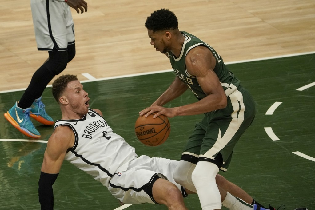 Brooklyn Nets' Blake Griffin draws a charge on Milwaukee Bucks' Giannis Antetokounmpo during the second half of an NBA basketball game Sunday, May 2, ...