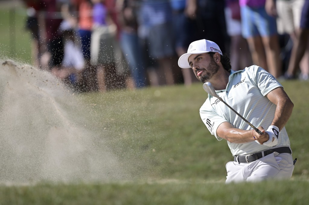 Abraham Ancer, of Mexico, hits from a bunker onto the 16th green during the final round of the Valspar Championship golf tournament, Sunday, May 2, 20...