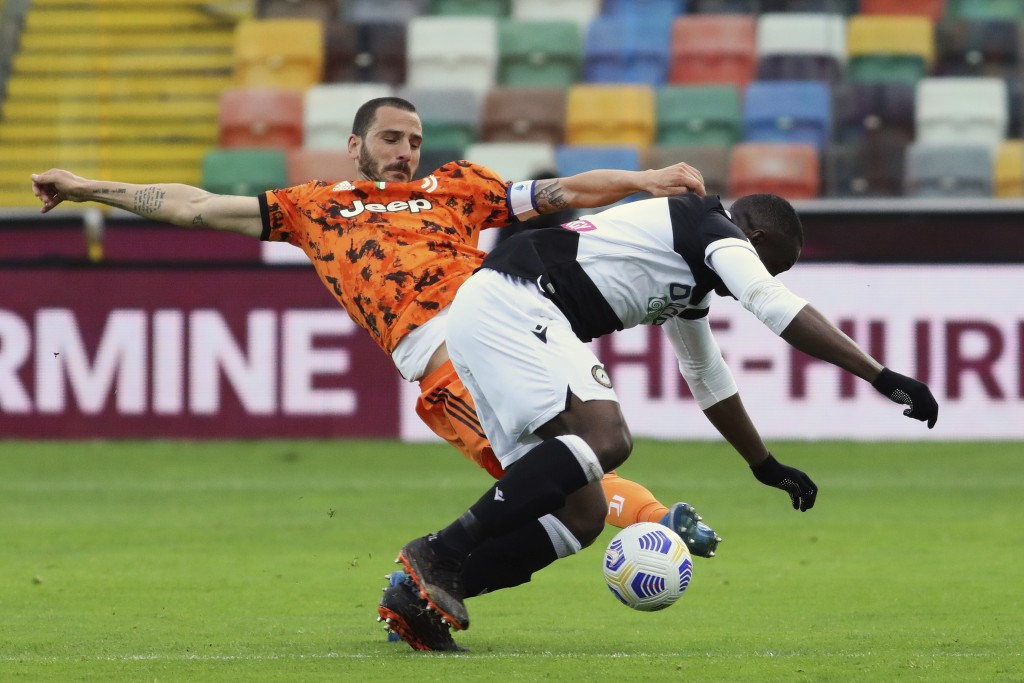 Udinese's Stefano Okaka, right, and Juventus' Leonardo Bonucci vie for the ball during the Italian Serie A soccer match between Udinese and Juventus a...