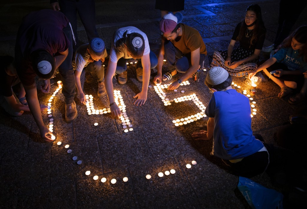Israeli youths light candles in memory of the 45 ultra-Orthodox Jews killed in a stampede at a religious festival on Friday, during a vigil in Tel Avi...