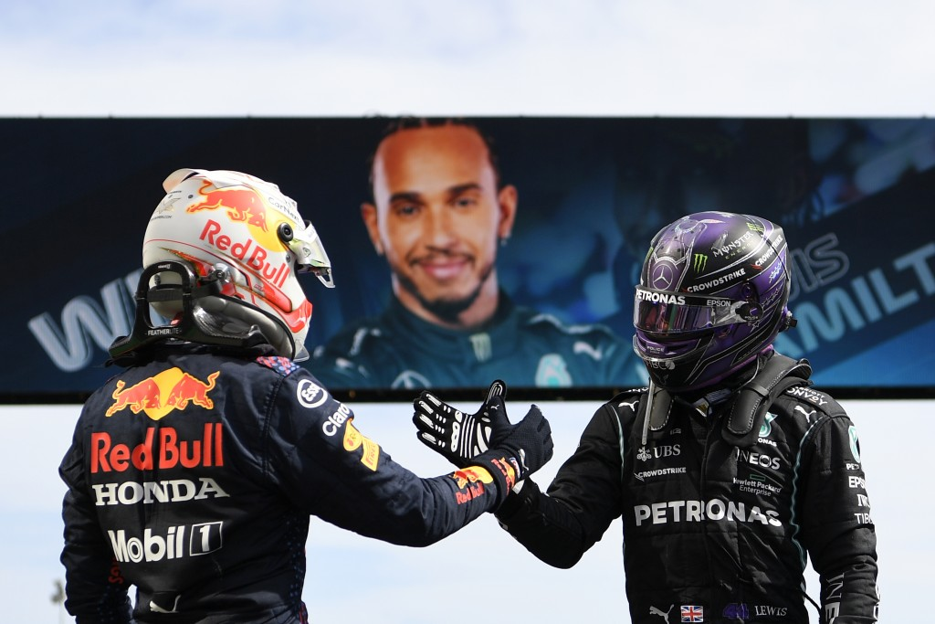 Winner Mercedes driver Lewis Hamilton of Britain, right, shakes hands with second placed Red Bull driver Max Verstappen of the Netherlands after the P...