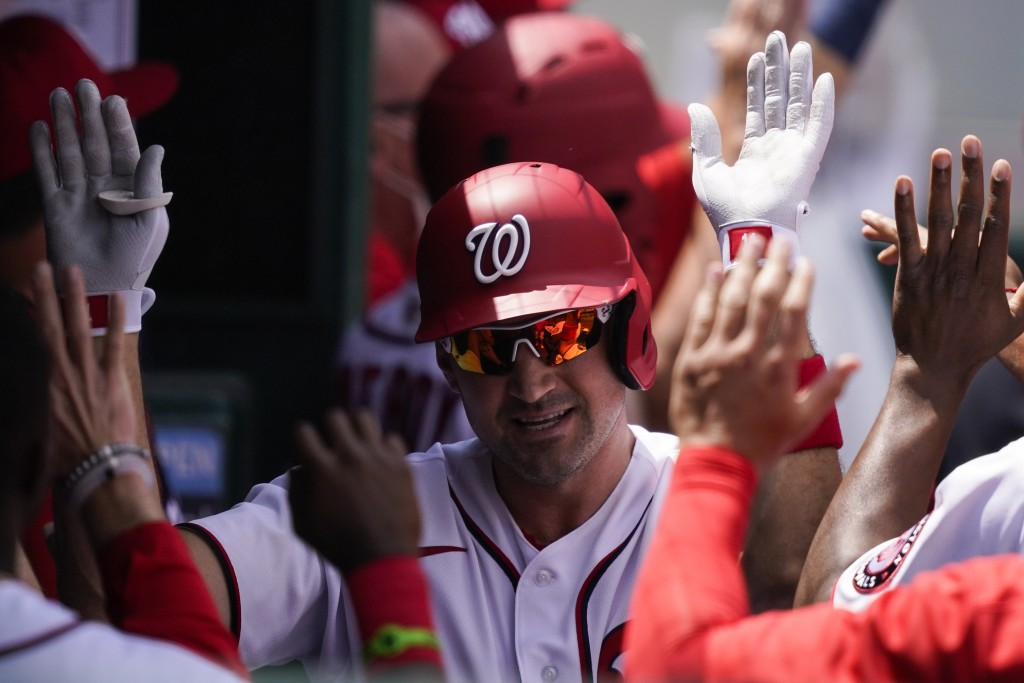 Washington Nationals' Ryan Zimmerman, center, celebrates his three-run homer with his teammates during the third inning of a baseball game against the...