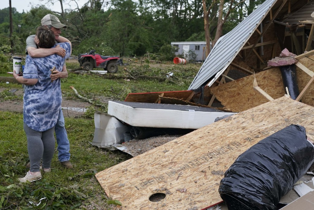 A neighbor hugs Vickie Savell next to the remains of her new mobile home early Monday, May 3, 2021, in Yazoo County, Miss. Multiple tornadoes were rep...