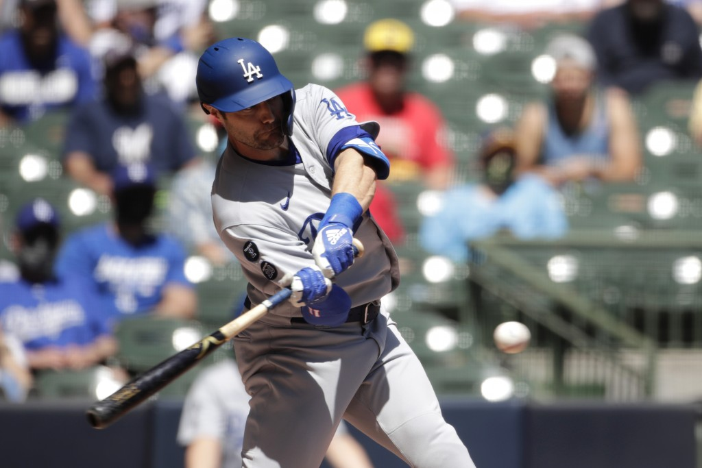 Los Angeles Dodgers' AJ Pollock hits a grand slam during the first inning of a baseball game against the Milwaukee Brewers Sunday, May 2, 2021, in Mil...