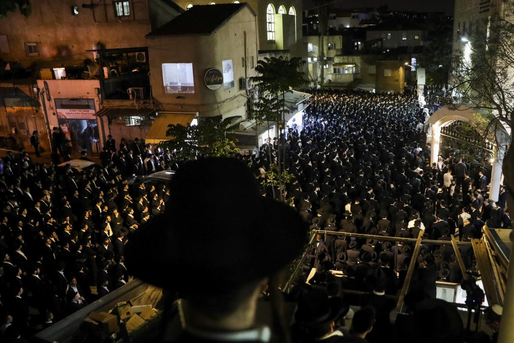 Ultra-Orthodox Jewish men attend the funeral of Yossi Kohn, 21, from Cleveland, Ohio, who died during Lag BaOmer celebrations at Mt. Meron in northern...