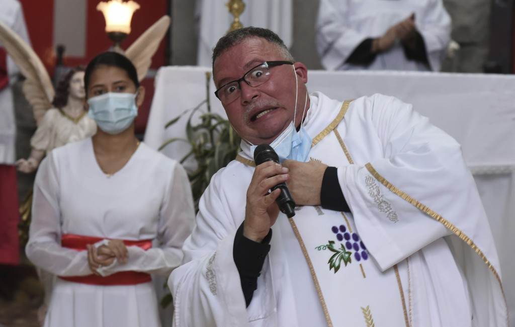 "Sergio Valverde Espinoza, a Catholic priest of the Cristo Rey church who modified a popular song called ""Sopa de Caracol,"" or Snail Soup in English, g..."