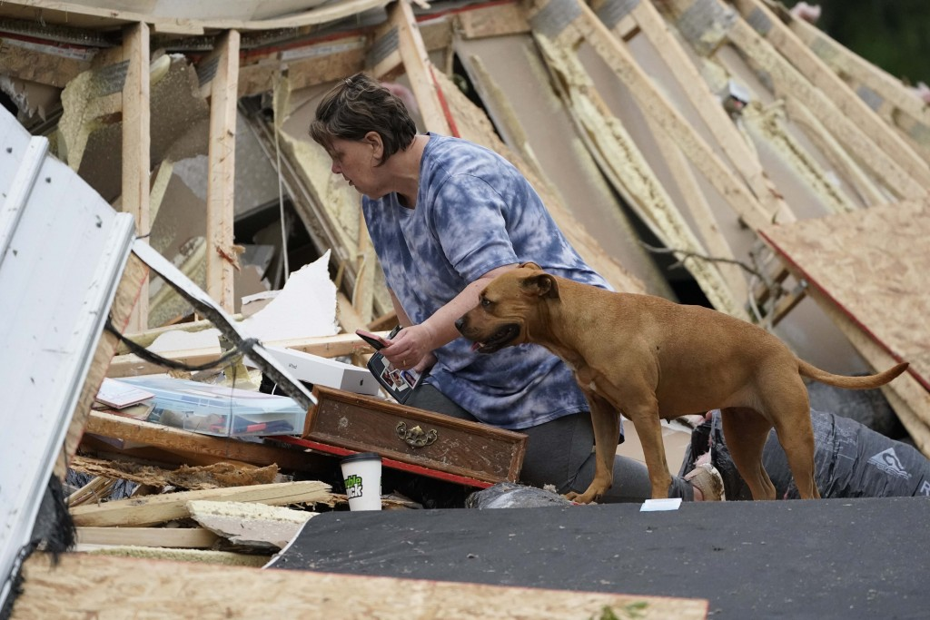 Vickie Savell looks through her belongings amid the remains of her new mobile home early Monday, May 3, 2021, in Yazoo County, Miss. Multiple tornadoe...