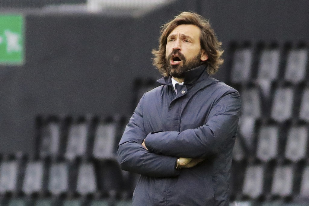 Juventus coach Andrea Pirlo shouts instructions during the Italian Serie A soccer match between Udinese and Juventus at the Dacia Arena stadium in Udi...
