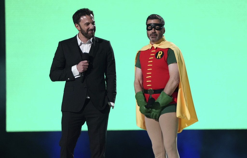 """Ben Affleck and Jimmy Kimmel speak at """"Vax Live: The Concert to Reunite the World"""" on Sunday, May 2, 2021, at SoFi Stadium in Inglewood, Calif. (Photo..."""