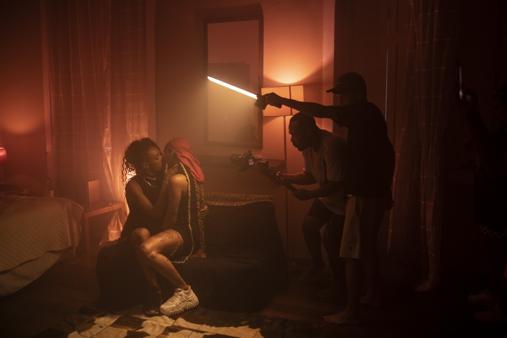 "Director Diego Esteves and cameraman Wellington Maga work on the music video Deep Web by Trap de Cria artist ""Thai Flow,"" at a hotel in Rio de Janeiro..."