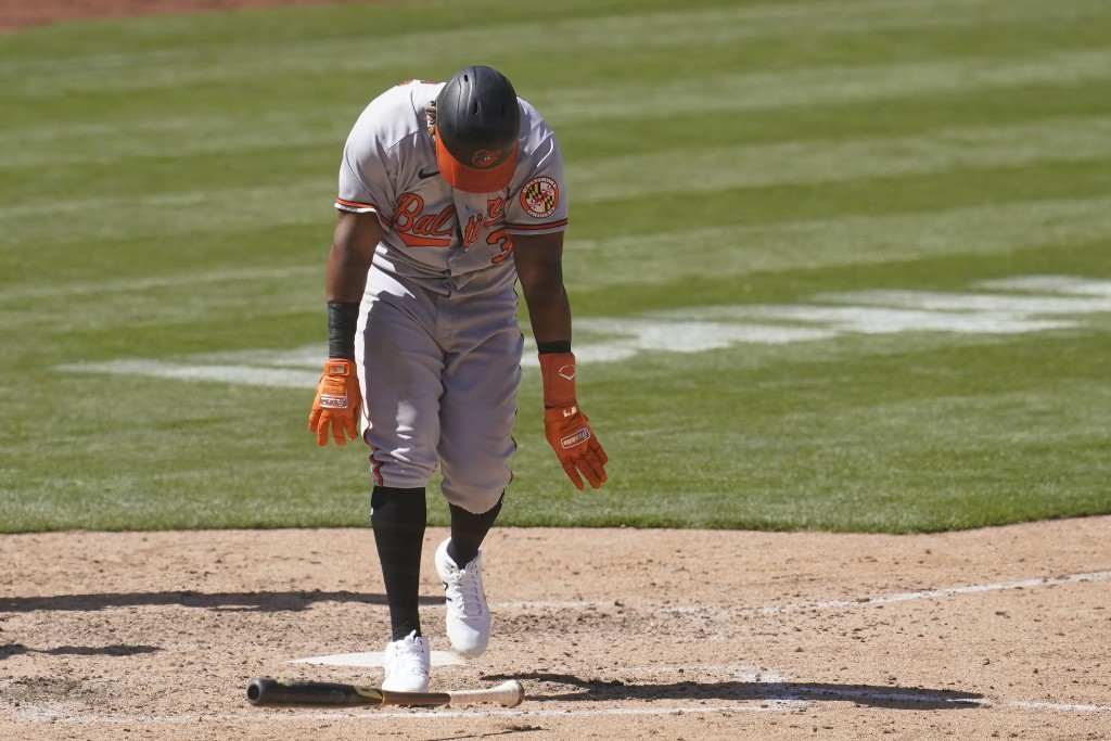 Baltimore Orioles' Maikel Franco throws down his bat after striking out against the Oakland Athletics during the seventh inning of a baseball game in ...