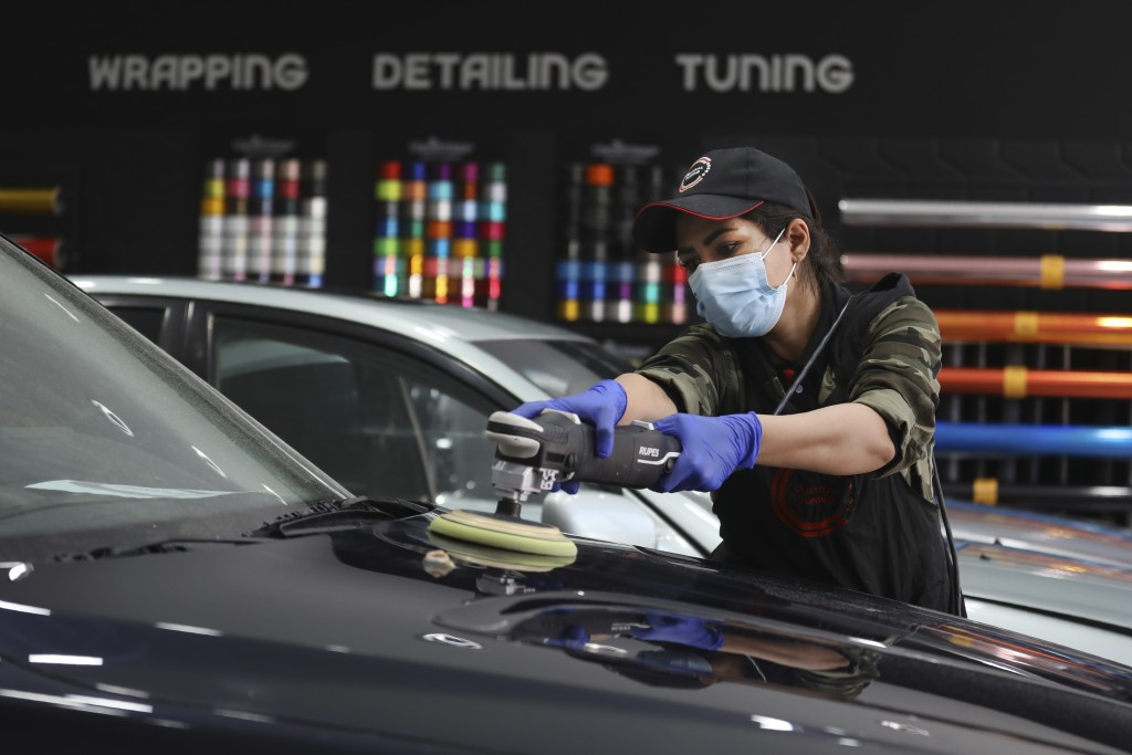 Iranian car detailer Maryam Roohani polishes a car at a detailing shop in Tehran, Iran, April 18, 2021. Roohani has battled skeptics and stereotypes t...