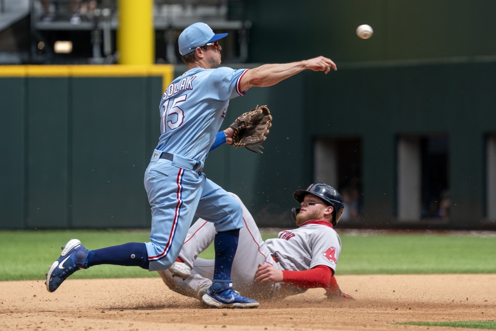 Texas Rangers second baseman Nick Solak (15) forces out Boston Red Sox's Alex Verdugo as he turns a double play during the fifth inning of a baseball ...