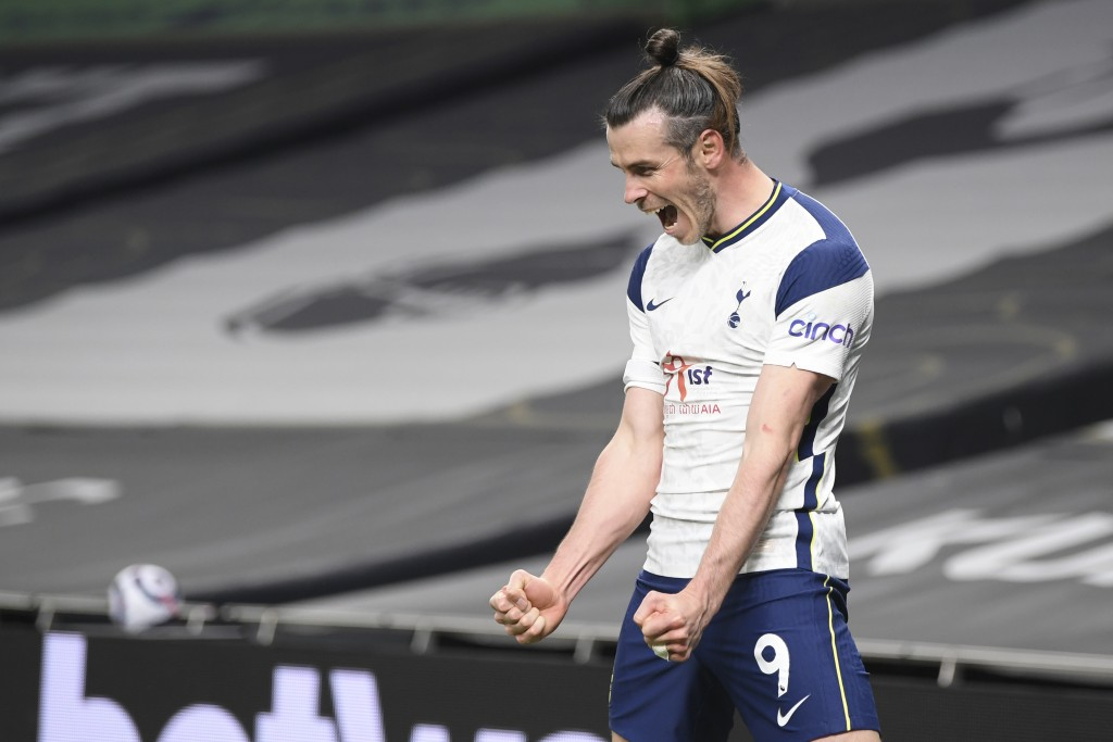 Tottenham's Gareth Bale celebrates after scoring his side's third goal during the English Premier League soccer match between Tottenham and Sheffield ...